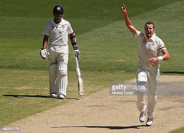 Peter Siddle kisses celebrates bowling out Karn Sharma of India during day four of the First Test match between Australia and India at Adelaide Oval...