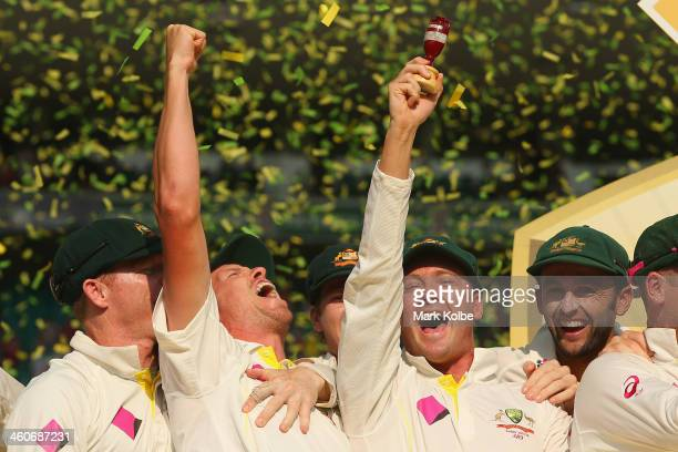 Peter Siddle Michael Clarke and Nathan Lyon of Australia celebrate with the urn during the presentation ceremony during day three of the Fifth Ashes...