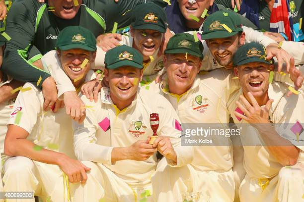 Peter Siddle Michael Clarke Steve Smith Brad Haddin Nathan Lyon and David Warner of Australia celebrate with the urn during the presentation ceremony...
