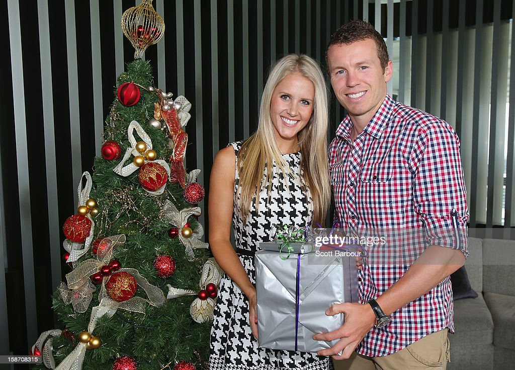 <a gi-track='captionPersonalityLinkClicked' href=/galleries/search?phrase=Peter+Siddle&family=editorial&specificpeople=2104718 ng-click='$event.stopPropagation()'>Peter Siddle</a> of Australia and partner Anna Weatherlake pose next to a Christmas tree ahead of a Cricket Australia Christmas Day lunch at Crown Entertainment Complex on December 25, 2012 in Melbourne, Australia.