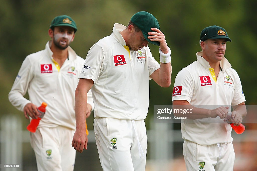 Peter Siddle of Australia and team mates react at the conclusion of play on day five of the Second Test Match between Australia and South Africa at Adelaide Oval on November 26, 2012 in Adelaide, Australia.