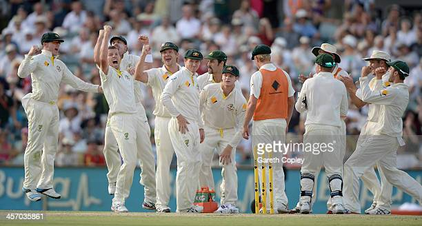 Peter Siddle of Australia and teammates celebrate after Ian Bell of England is given out by the 3rd umpire during day four of the Third Ashes Test...