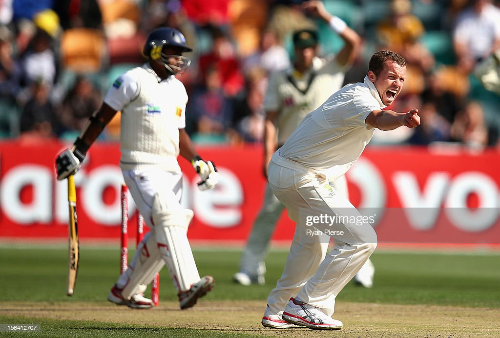 <a gi-track='captionPersonalityLinkClicked' href=/galleries/search?phrase=Peter+Siddle&family=editorial&specificpeople=2104718 ng-click='$event.stopPropagation()'>Peter Siddle</a> of Australia appeals for the wicket of <a gi-track='captionPersonalityLinkClicked' href=/galleries/search?phrase=Rangana+Herath&family=editorial&specificpeople=2303669 ng-click='$event.stopPropagation()'>Rangana Herath</a> of Sri Lanka during day three of the First Test match between Australia and Sri Lanka at Blundstone Arena on December 16, 2012 in Hobart, Australia.