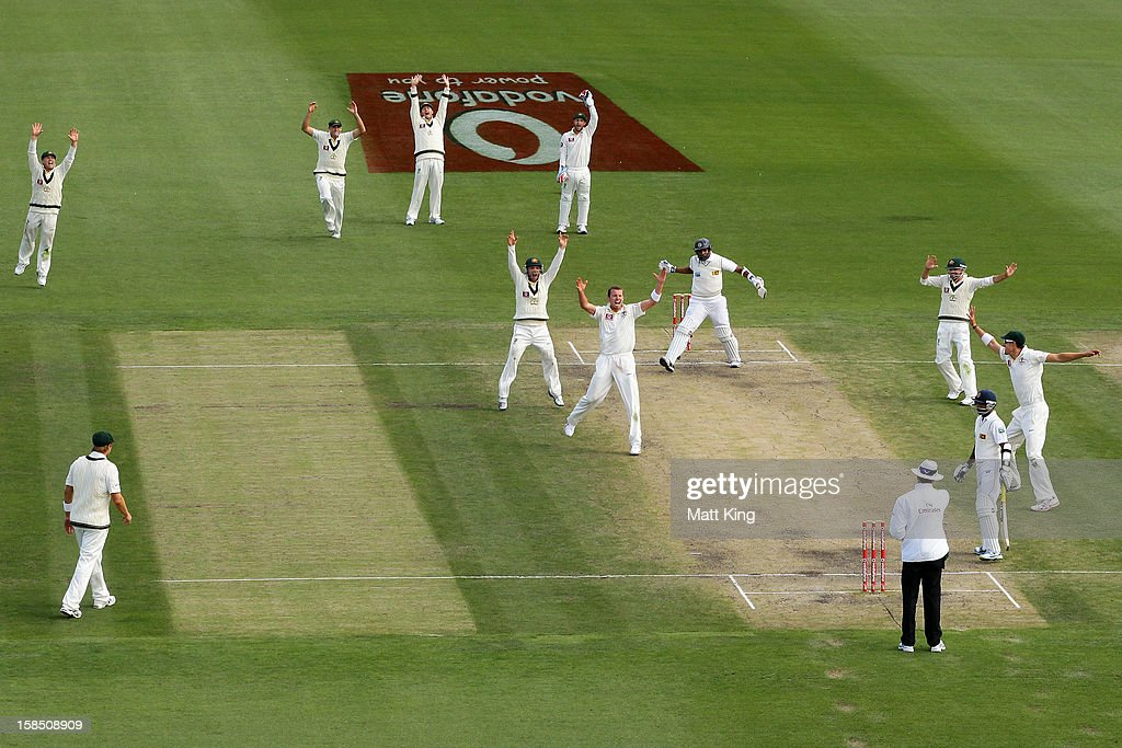 <a gi-track='captionPersonalityLinkClicked' href=/galleries/search?phrase=Peter+Siddle&family=editorial&specificpeople=2104718 ng-click='$event.stopPropagation()'>Peter Siddle</a> of Australia appeals successfully for the wicket of <a gi-track='captionPersonalityLinkClicked' href=/galleries/search?phrase=Thilan+Samaraweera&family=editorial&specificpeople=240324 ng-click='$event.stopPropagation()'>Thilan Samaraweera</a> of Sri Lanka during day five of the First Test match between Australia and Sri Lanka at Blundstone Arena on December 18, 2012 in Hobart, Australia.