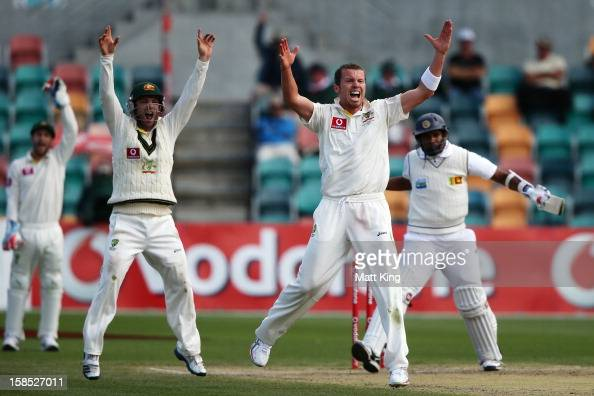 Peter Siddle of Australia appeals successfully for the wicket of Thilan Samaraweera of Sri Lanka during day five of the First Test match between...