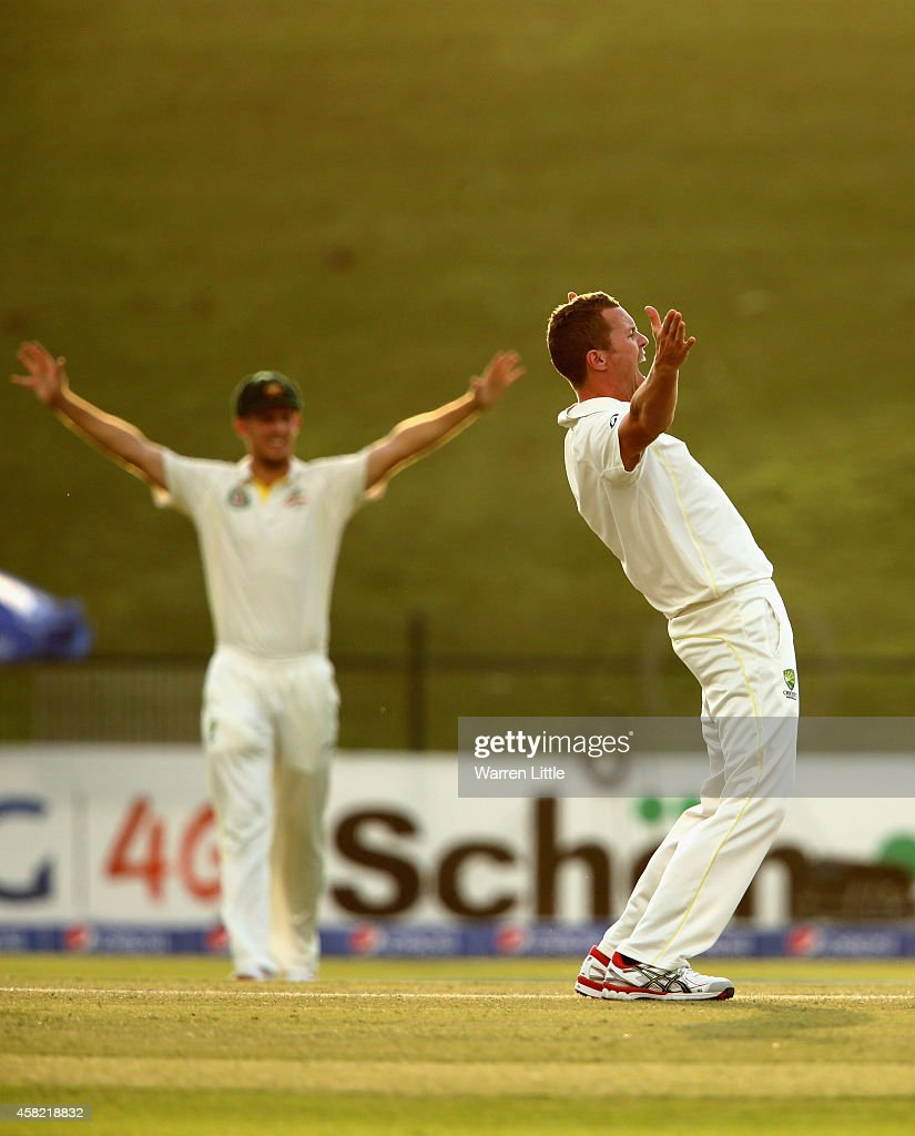 Peter Siddle of Australia appeals unsuccesfully for the wick of Younis Khan of Pakistan during Day Three of the Second Test between Pakistan and Australia at Sheikh Zayed Stadium on November 1, 2014 in Abu Dhabi, United Arab Emirates.