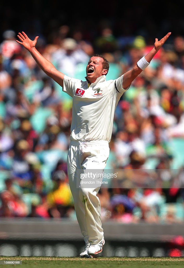 <a gi-track='captionPersonalityLinkClicked' href=/galleries/search?phrase=Peter+Siddle&family=editorial&specificpeople=2104718 ng-click='$event.stopPropagation()'>Peter Siddle</a> of Australia celebrates after claiming the wicket of Thilan Samaraweera of Sri Lanka during day one of the Third Test match between Australia and Sri Lanka at the Sydney Cricket Ground on January 3, 2013 in Sydney, Australia.