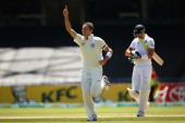 Peter Siddle of Australia celebrates after he took the wicket of Kevin Pietersen of England during day three of the Second Ashes Test match between...