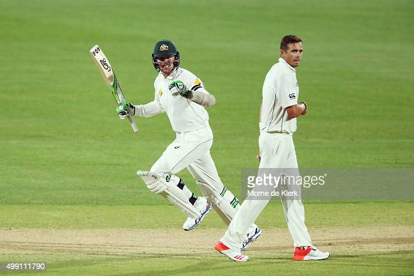 Peter Siddle of Australia celebrates after hitting the winning runs as Tim Southee of New Zealand looks on during day three of the Third Test match...