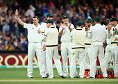 Peter Siddle of Australia celebrates after taking his 200th Test Wicket the wicket of Doug Bracewell of New Zealand during day one of the Third Test...