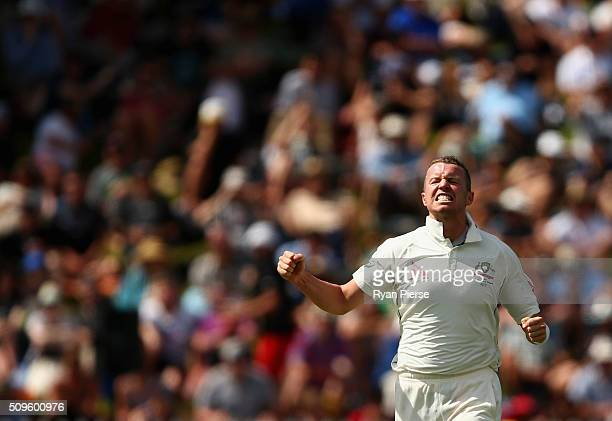 Peter Siddle of Australia celebrates after taking the wicket of Henry Nicholls of New Zealand during day one of the Test match between New Zealand...