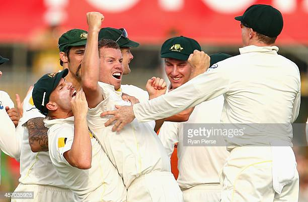 Peter Siddle of Australia celebrates after taking the wicket of Ian Bell of England during day four of the Third Ashes Test Match between Australia...