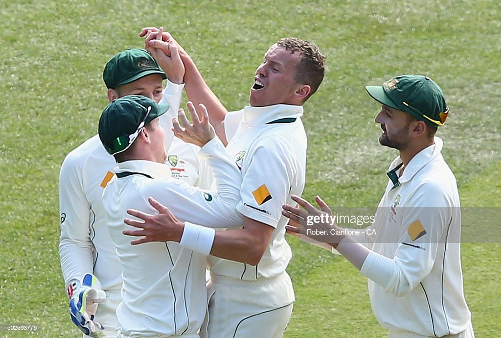 <a gi-track='captionPersonalityLinkClicked' href=/galleries/search?phrase=Peter+Siddle&family=editorial&specificpeople=2104718 ng-click='$event.stopPropagation()'>Peter Siddle</a> of Australia celebrates after taking the wicket of <a gi-track='captionPersonalityLinkClicked' href=/galleries/search?phrase=Jason+Holder&family=editorial&specificpeople=6681136 ng-click='$event.stopPropagation()'>Jason Holder</a> of the West Indies during day two of the Second Test match between Australia and the West Indies at the Melbourne Cricket Ground on December 27, 2015 in Melbourne, Australia.