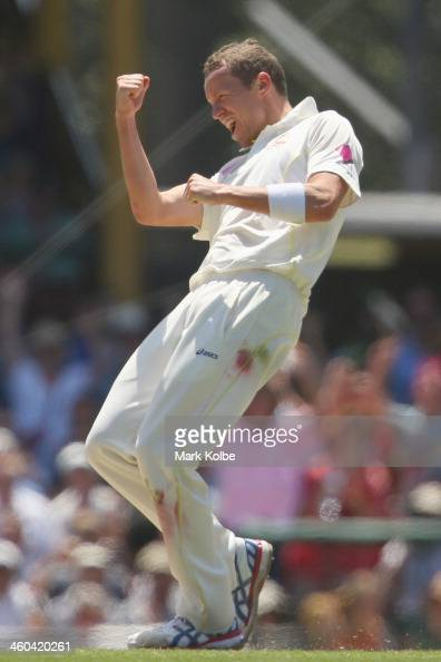 Peter Siddle of Australia celebrates after taking the wicket of Jonny Bairstow of England during day two of the Fifth Ashes Test match between...