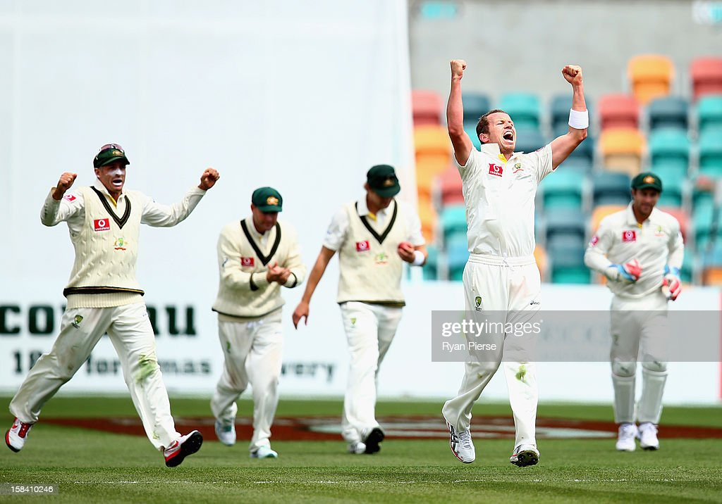 <a gi-track='captionPersonalityLinkClicked' href=/galleries/search?phrase=Peter+Siddle&family=editorial&specificpeople=2104718 ng-click='$event.stopPropagation()'>Peter Siddle</a> of Australia celebrates after taking the wicket of <a gi-track='captionPersonalityLinkClicked' href=/galleries/search?phrase=Angelo+Mathews&family=editorial&specificpeople=5622021 ng-click='$event.stopPropagation()'>Angelo Mathews</a> of Sri Lanka during day three of the First Test match between Australia and Sri Lanka at Blundstone Arena on December 16, 2012 in Hobart, Australia.