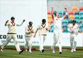 Peter Siddle of Australia celebrates after taking the wicket of Angelo Mathews of Sri Lanka during day three of the First Test match between...