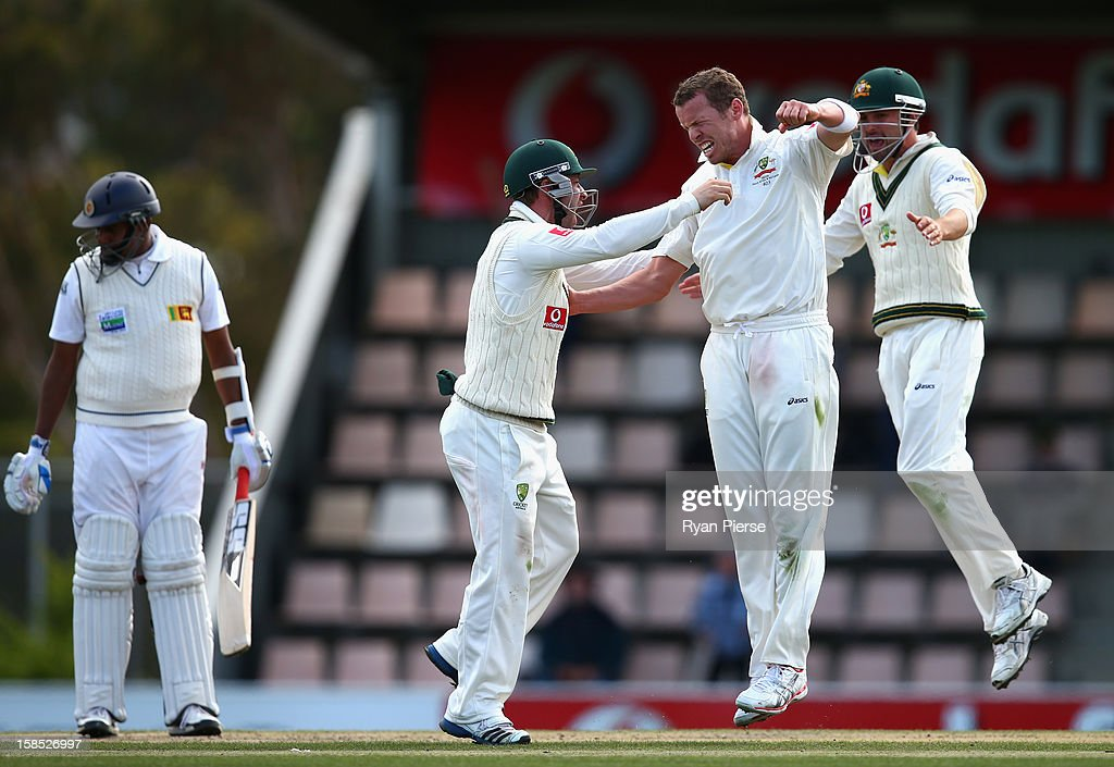 <a gi-track='captionPersonalityLinkClicked' href=/galleries/search?phrase=Peter+Siddle&family=editorial&specificpeople=2104718 ng-click='$event.stopPropagation()'>Peter Siddle</a> of Australia celebrates after taking the wicket of <a gi-track='captionPersonalityLinkClicked' href=/galleries/search?phrase=Thilan+Samaraweera&family=editorial&specificpeople=240324 ng-click='$event.stopPropagation()'>Thilan Samaraweera</a> of Sri Lanka during day five of the First Test match between Australia and Sri Lanka at Blundstone Arena on December 18, 2012 in Hobart, Australia.