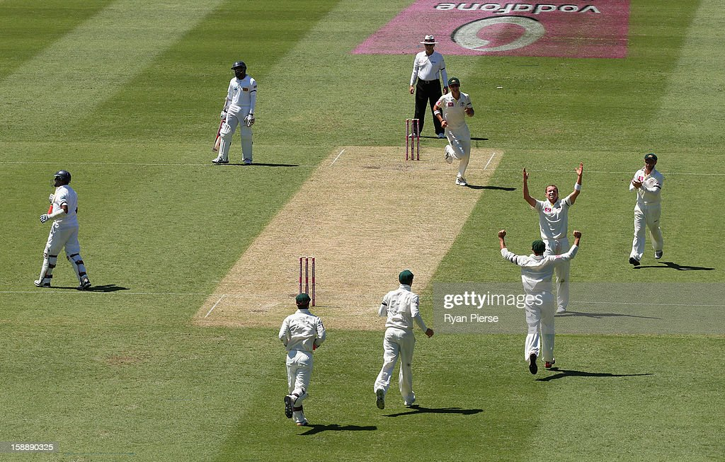 Peter Siddle of Australia celebrates after taking the wicket of Thilan Samaraweera of Sri Lanka during day one of the Third Test match between...