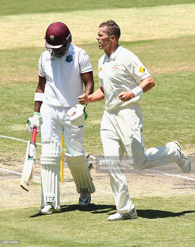 <a gi-track='captionPersonalityLinkClicked' href=/galleries/search?phrase=Peter+Siddle&family=editorial&specificpeople=2104718 ng-click='$event.stopPropagation()'>Peter Siddle</a> of Australia celebrates after taking the wicket of <a gi-track='captionPersonalityLinkClicked' href=/galleries/search?phrase=Darren+Bravo&family=editorial&specificpeople=4884685 ng-click='$event.stopPropagation()'>Darren Bravo</a> of the West Indies during day four of the Second Test match between Australia and the West Indies at the Melbourne Cricket Ground on December 29, 2015 in Melbourne, Australia.