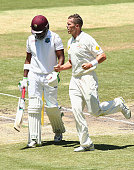 Peter Siddle of Australia celebrates after taking the wicket of Darren Bravo of the West Indies during day four of the Second Test match between...