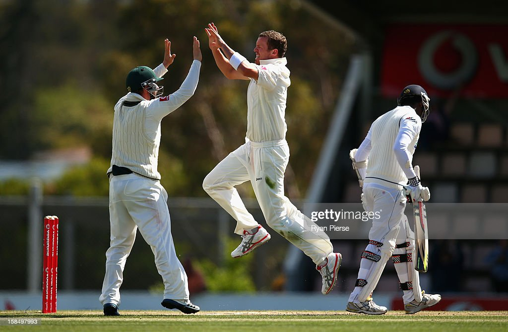 Peter Siddle of Australia celebrates aftertaking the wicket of Angelo Mathews of Sri Lanka during day five of the First Test match between Australia and Sri Lanka at Blundstone Arena on December 18, 2012 in Hobart, Australia.