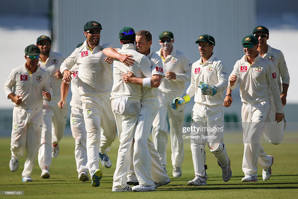 <a gi-track='captionPersonalityLinkClicked' href=/galleries/search?phrase=Peter+Siddle&family=editorial&specificpeople=2104718 ng-click='$event.stopPropagation()'>Peter Siddle</a> of Australia celebrates dismissing <a gi-track='captionPersonalityLinkClicked' href=/galleries/search?phrase=Dale+Steyn&family=editorial&specificpeople=649553 ng-click='$event.stopPropagation()'>Dale Steyn</a> of South Africa during day five of the Second Test Match between Australia and South Africa at Adelaide Oval on November 26, 2012 in Adelaide, Australia.