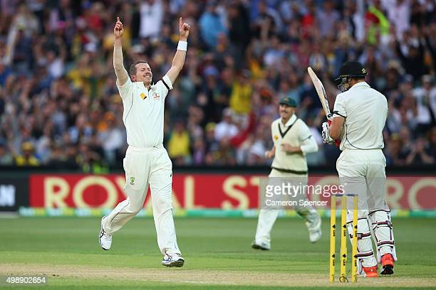 Peter Siddle of Australia celebrates dismissing Doug Bracewell of New Zealand his 200th test wicket during day one of the Third Test match between...