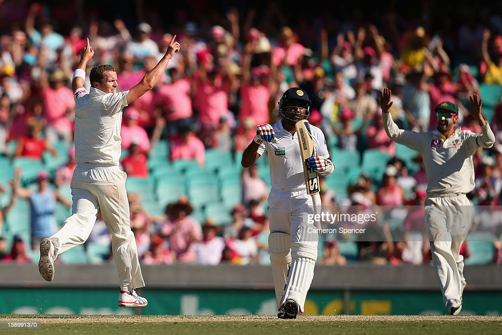 <a gi-track='captionPersonalityLinkClicked' href=/galleries/search?phrase=Peter+Siddle&family=editorial&specificpeople=2104718 ng-click='$event.stopPropagation()'>Peter Siddle</a> of Australia celebrates dismissing <a gi-track='captionPersonalityLinkClicked' href=/galleries/search?phrase=Mahela+Jayawardene&family=editorial&specificpeople=213707 ng-click='$event.stopPropagation()'>Mahela Jayawardene</a> of Sri Lanka during day three of the Third Test match between Australia and Sri Lanka at Sydney Cricket Ground on January 5, 2013 in Sydney, Australia.