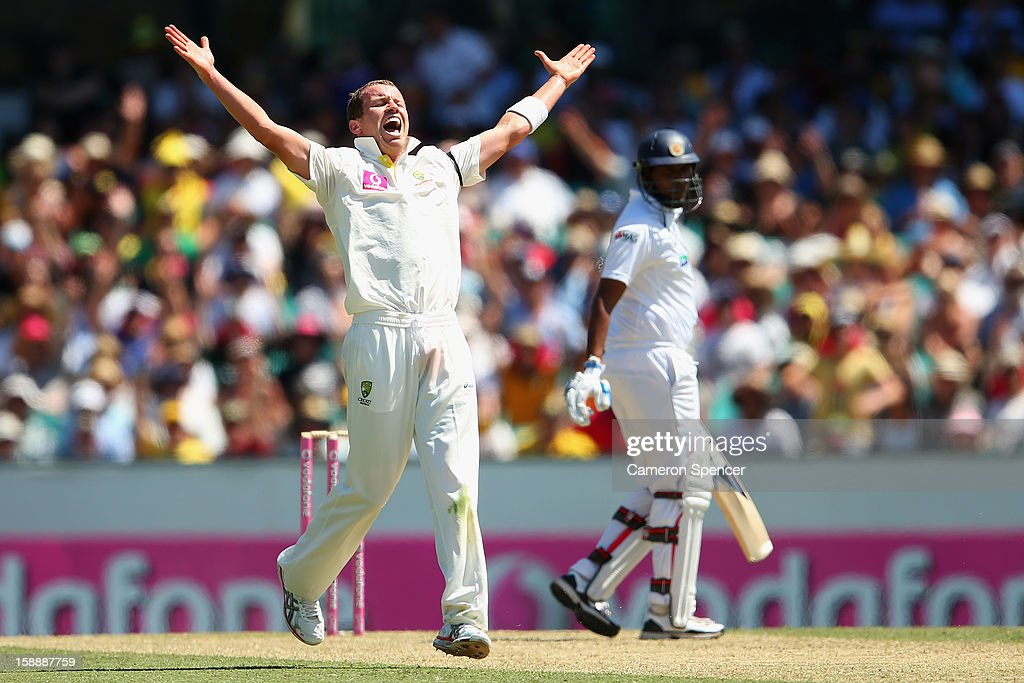 <a gi-track='captionPersonalityLinkClicked' href=/galleries/search?phrase=Peter+Siddle&family=editorial&specificpeople=2104718 ng-click='$event.stopPropagation()'>Peter Siddle</a> of Australia celebrates dismissing <a gi-track='captionPersonalityLinkClicked' href=/galleries/search?phrase=Thilan+Samaraweera&family=editorial&specificpeople=240324 ng-click='$event.stopPropagation()'>Thilan Samaraweera</a> of Sri Lanka for lbw during day one of the Third Test match between Australia and Sri Lanka at the Sydney Cricket Ground on January 3, 2013 in Sydney, Australia.