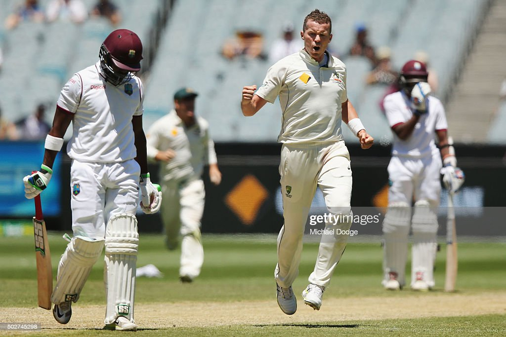 <a gi-track='captionPersonalityLinkClicked' href=/galleries/search?phrase=Peter+Siddle&family=editorial&specificpeople=2104718 ng-click='$event.stopPropagation()'>Peter Siddle</a> of Australia celebrates his wicket of <a gi-track='captionPersonalityLinkClicked' href=/galleries/search?phrase=Darren+Bravo&family=editorial&specificpeople=4884685 ng-click='$event.stopPropagation()'>Darren Bravo</a> of the West Indies during day four of the Second Test match between Australia and the West Indies at Melbourne Cricket Ground on December 29, 2015 in Melbourne, Australia.