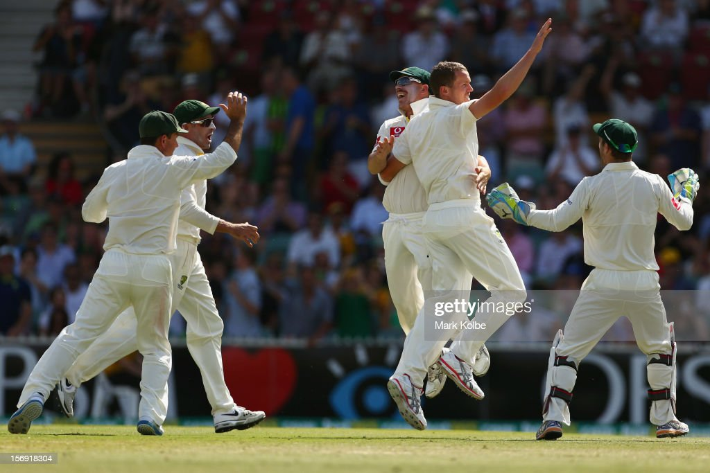 <a gi-track='captionPersonalityLinkClicked' href=/galleries/search?phrase=Peter+Siddle&family=editorial&specificpeople=2104718 ng-click='$event.stopPropagation()'>Peter Siddle</a> of Australia celebrates taking the wicket of Alviro Petersen of South Africa during day four of the Second Test Match between Australia and South Africa at Adelaide Oval on November 25, 2012 in Adelaide, Australia.