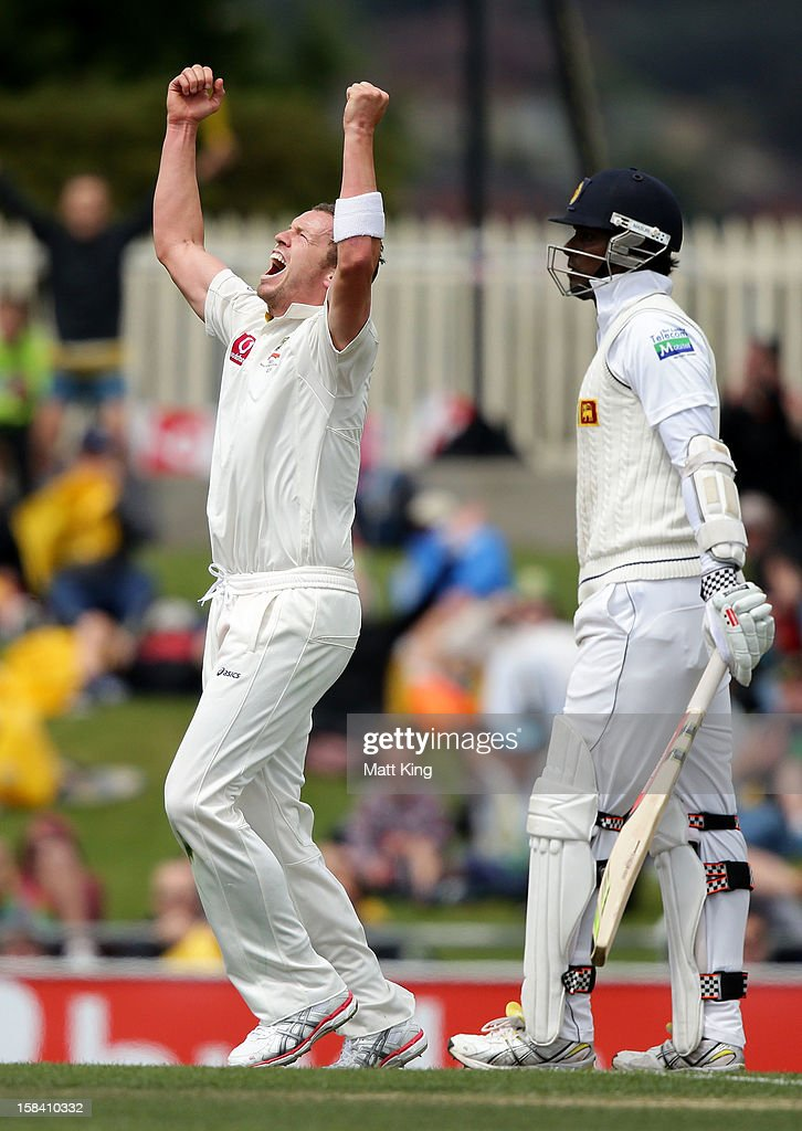 Peter Siddle of Australia celebrates taking the wicket of Angelo Mathews of Sri Lanka during day three of the First Test match between Australia and Sri Lanka at Blundstone Arena on December 16, 2012 in Hobart, Australia.
