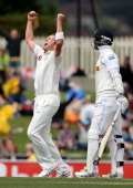 Peter Siddle of Australia celebrates taking the wicket of Angelo Mathews of Sri Lanka during day three of the First Test match between Australia and...