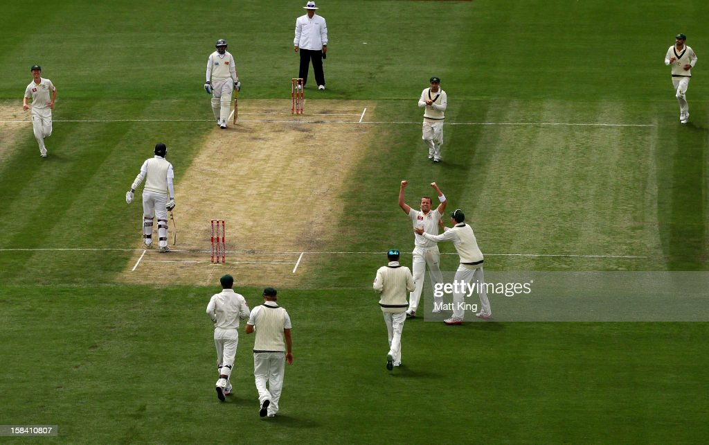 <a gi-track='captionPersonalityLinkClicked' href=/galleries/search?phrase=Peter+Siddle&family=editorial&specificpeople=2104718 ng-click='$event.stopPropagation()'>Peter Siddle</a> of Australia celebrates taking the wicket of <a gi-track='captionPersonalityLinkClicked' href=/galleries/search?phrase=Angelo+Mathews&family=editorial&specificpeople=5622021 ng-click='$event.stopPropagation()'>Angelo Mathews</a> of Sri Lanka during day three of the First Test match between Australia and Sri Lanka at Blundstone Arena on December 16, 2012 in Hobart, Australia.