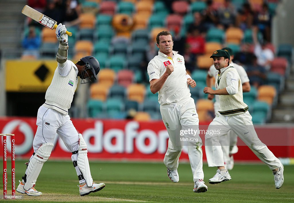Peter Siddle of Australia celebrates taking the wicket of Kumar Sangakkara of Sri Lanka during day two of the First Test match between Australia and Sri Lanka at Blundstone Arena on December 15, 2012 in Hobart, Australia.