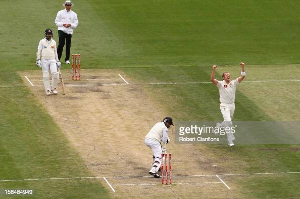Peter Siddle of Australia celebrates the wicket of Mahela Jayawardene of Sri Lanka during day five of the First Test match between Australia and Sri...