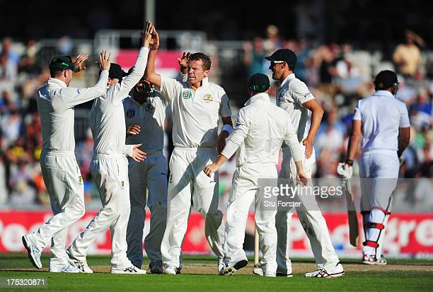Peter Siddle of Australia celebrates the wicket of Tim Bresnan of England with team mates during day two of the 3rd Investec Ashes Test match between...