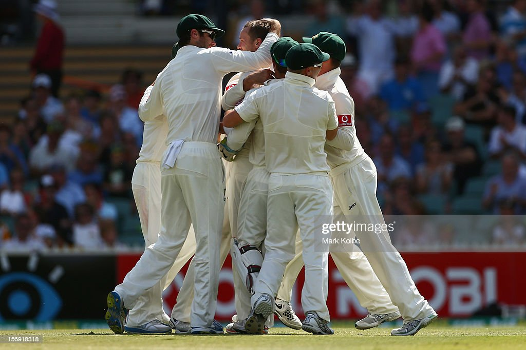 Peter Siddle of Australia celebrates with his team mates taking the wicket of Alviro Petersen of South Africa during day four of the Second Test Match between Australia and South Africa at Adelaide Oval on November 25, 2012 in Adelaide, Australia.