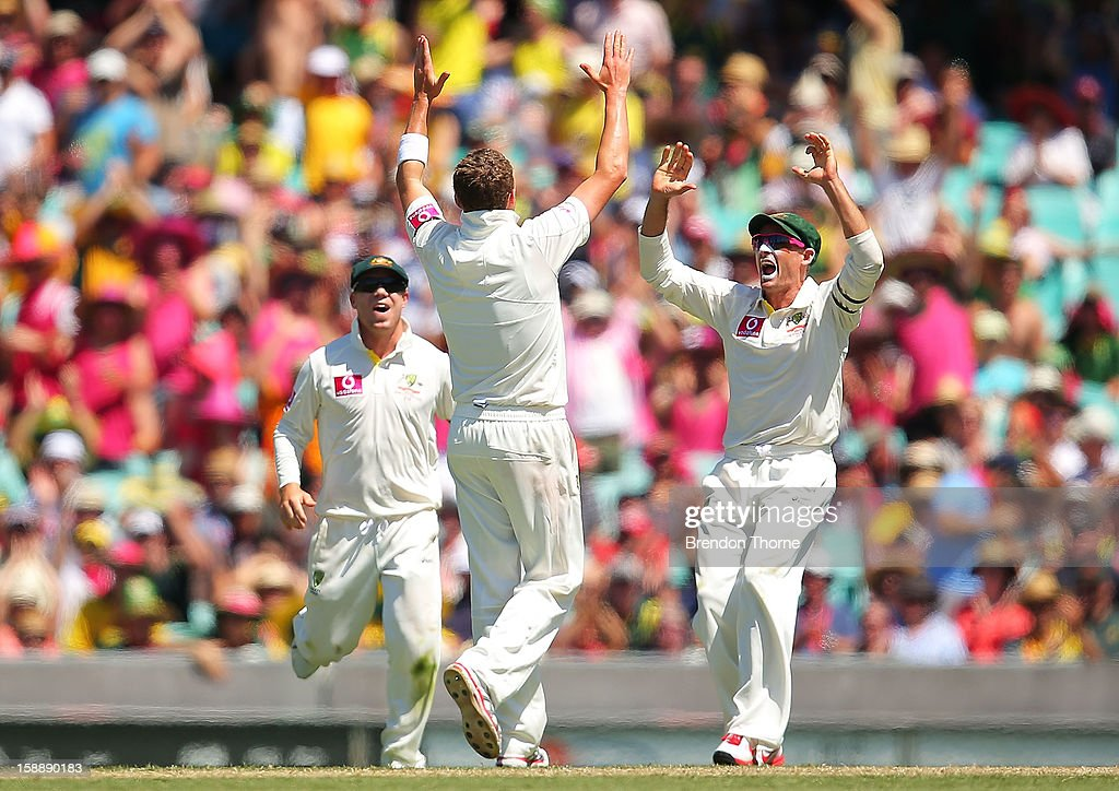 Peter Siddle of Australia celebrates with team mate Michael Hussey after claiming the wicket of Thilan Samaraweera of Sri Lanka during day one of the Third Test match between Australia and Sri Lanka at the Sydney Cricket Ground on January 3, 2013 in Sydney, Australia.