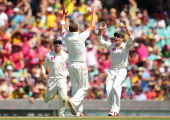 Peter Siddle of Australia celebrates with team mate Michael Hussey after claiming the wicket of Thilan Samaraweera of Sri Lanka during day one of the...