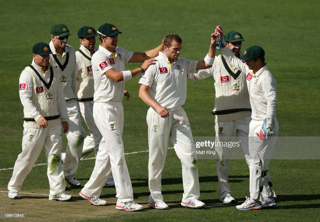 Peter Siddle (C) of Australia celebrates with team mates after taking the wicket of Rangana Herath of Sri Lanka during day three of the First Test match between Australia and Sri Lanka at Blundstone Arena on December 16, 2012 in Hobart, Australia.