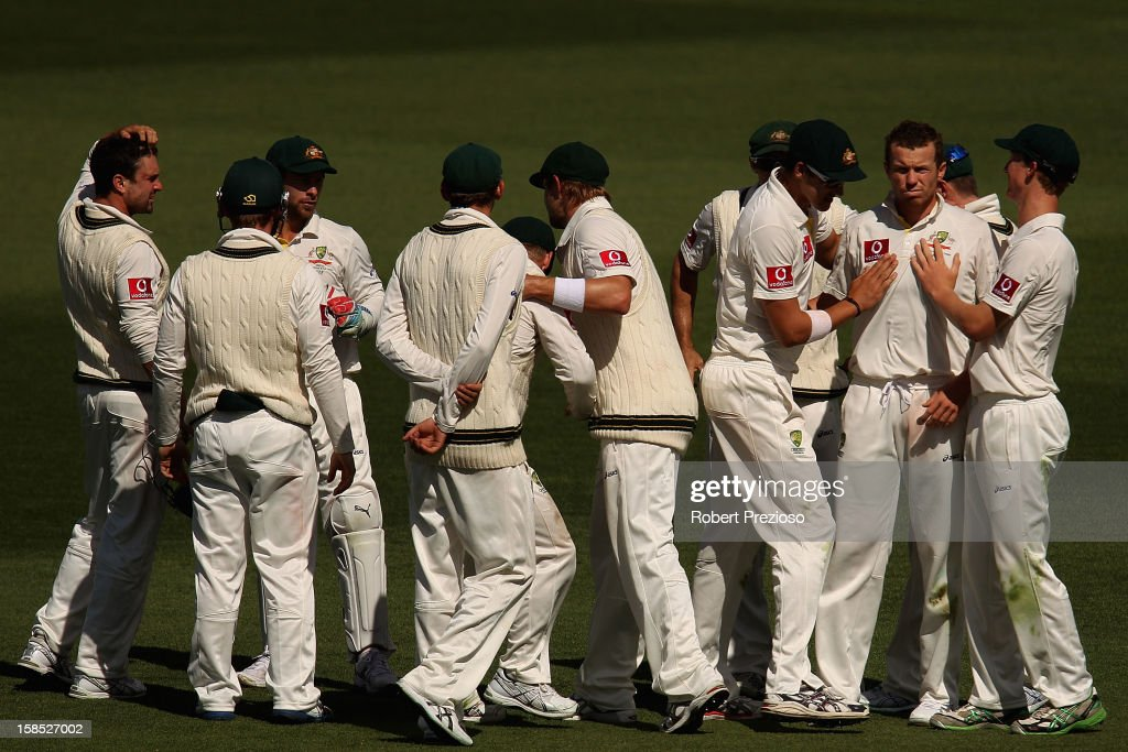 Peter Siddle of Australia celebrates with team-mates taking the wicket of Angelo Mathews of Sri Lanka during day five of the First Test match between Australia and Sri Lanka at Blundstone Arena on December 18, 2012 in Hobart, Australia.