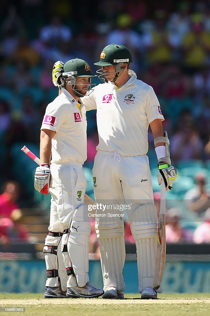 Peter Siddle of Australia congratulates team mate Matthew Wade on scoring fifty runs during day three of the Third Test match between Australia and Sri Lanka at the Sydney Cricket Ground on January 5, 2013 in Sydney, Australia.