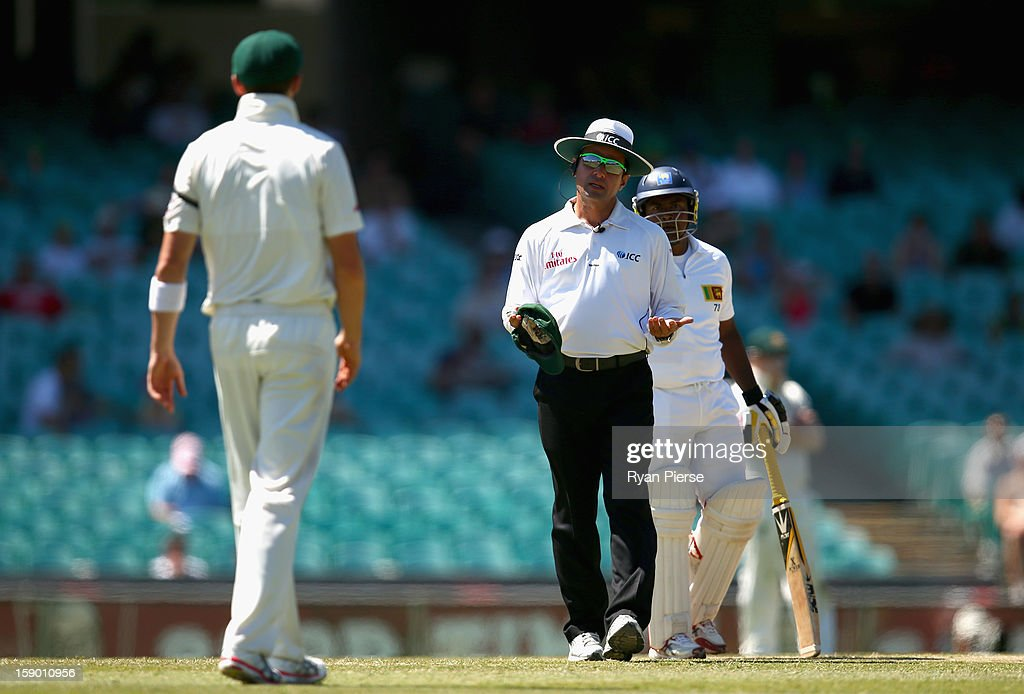Peter Siddle of Australia has words with Rangana Herath of Sri Lanka during day four of the Third Test match between Australia and Sri Lanka at Sydney Cricket Ground on January 6, 2013 in Sydney, Australia.