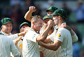 Peter Siddle of Australia is congratulated by his teammates after dismissing Jason Holder of the West Indies during day two of the Second Test match...