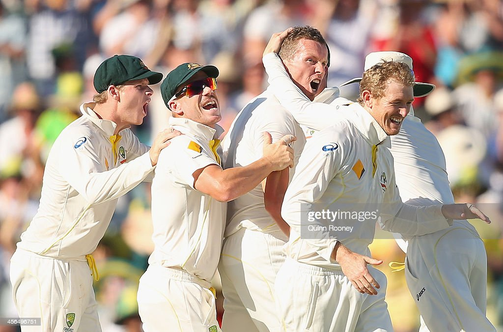 <a gi-track='captionPersonalityLinkClicked' href=/galleries/search?phrase=Peter+Siddle&family=editorial&specificpeople=2104718 ng-click='$event.stopPropagation()'>Peter Siddle</a> of Australia is congratulated byteam mates after taking the wicket of Kevin Pietersen of England during day two of the Third Ashes Test Match between Australia and England at WACA on December 14, 2013 in Perth, Australia.