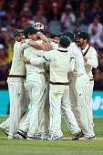 Peter Siddle of Australia is swamped by teammates after he got his 200th wicket during day one of the Third Test match between Australia and New...