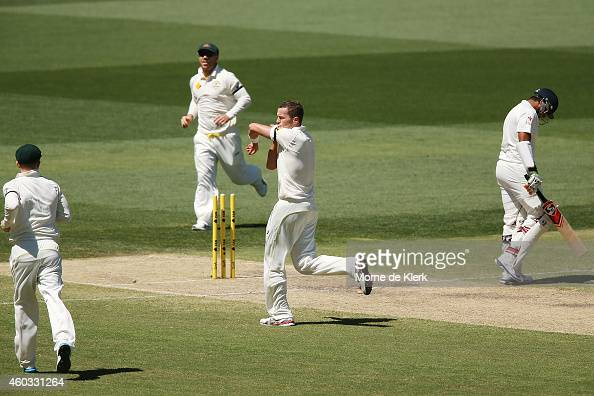 Peter Siddle of Australia kisses the black armband as he celebrates getting the wicket of Karn Sharma of India during day four of the First Test...