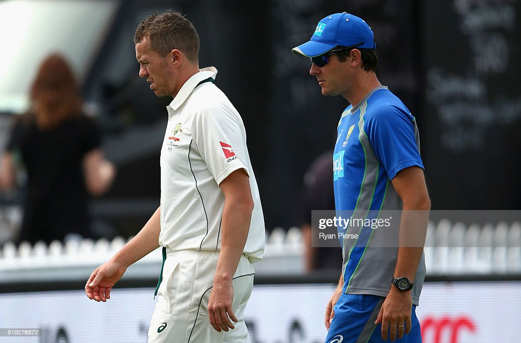 <a gi-track='captionPersonalityLinkClicked' href=/galleries/search?phrase=Peter+Siddle&family=editorial&specificpeople=2104718 ng-click='$event.stopPropagation()'>Peter Siddle</a> of Australia looks on with Australian Team Physiotherapist David Beakley during day four of the Test match between New Zealand and Australia at Basin Reserve on February 15, 2016 in Wellington, New Zealand.