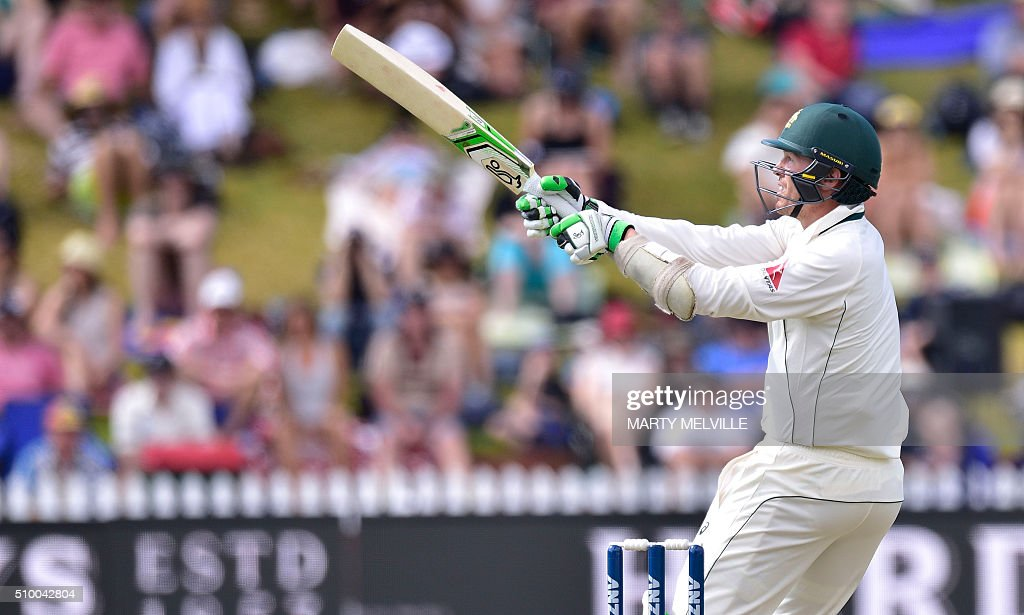 Peter Siddle of Australia plays a shot during day three of the first cricket Test match between New Zealand and Australia at the Basin Reserve in Wellington on February 14, 2016. / AFP / Marty Melville